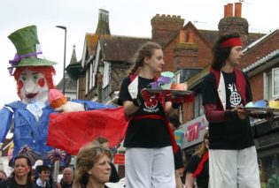 The procession in Uckfield Carnival with people on stilts