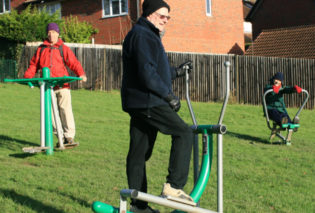Photo of adults using the adult gym equipment Hempstead Lane Uckfield