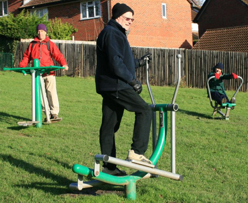 Photo of adults using the adult gym equipment Hempstead Lane Uckfield
