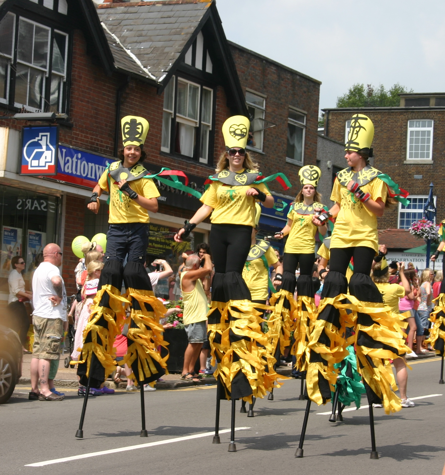 Uckfield Carnival procession with stilt walkers