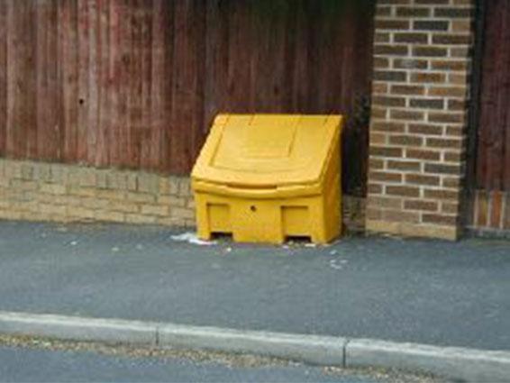 Yellow grit bin